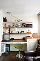 A light green bubble chair in the tidy study of interior designer Anna Johansson