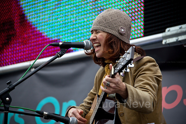 """Rebecca Thorn, Singer and musician - 2011<br /> <br /> London, 08/10/2011. Today Trafalgar Square was the stage of the """"Antiwar Mass Assembly"""" organised by The Stop The War Coalition to mark the 10th Anniversary of the invasion of Afghanistan. Thousands of people gathered in the square to listen to speeches given by journalists, activists, politicians, trade union leaders, MPs, ex-soldiers, relatives and parents of soldiers and civilians killed during the conflict, and to see the performances of actors, musicians, writers, filmmakers and artists. The speakers, among others, included: Jeremy Corbin, Joe Glenton, Seumas Milne, Brian Eno, Sukri Sultan and Shadia Edwards-Dashti, Hetty Bower, Mark Cambell, Sanum Ghafoor, Andrew Murray, Lauren Booth, Kate Hudson, Sami Ramadani, Yvone Ridley, Mark Rylance, Dave Randall, Roger Lloyd-Pack, Rebecca Thorn, Sanasino al Yemen, Elvis McGonagall, Lowkey (Kareem Dennis), Tony Benn, John Hilary, Bruce Kent, John Pilger, Billy Hayes, Alison Louise Kennedy, Joan Humpheries, Jemima Khan, Julian Assange, Lindsey German, George Galloway. At the end of the speeches a group of protesters marched toward Downing Street where after a peaceful occupation the police made some arrests."""