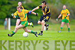 Gneeveguilla's Donal Murphy chases the loose ball against John Payne of Dr Crokes in Gneeveguilla last Sunday evening in round 1 of the Garvey's Supervalue County Senior Championship.