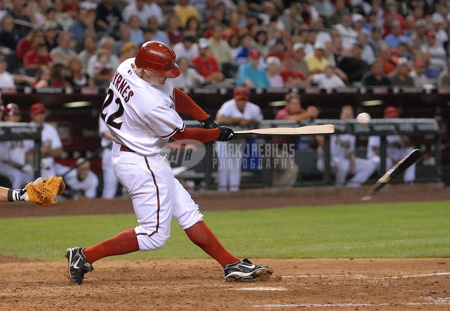 Apr 11, 2007; Phoenix, AZ, USA; Arizona Diamondbacks center fielder (22) Eric Byrnes breaks a bat against the Cincinnati Reds at Chase Field in Phoenix, AZ. Mandatory Credit: Mark J. Rebilas