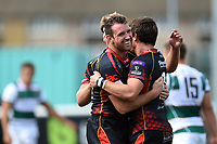 Rhodri Williams of the Dragons celebrates his first half try with team-mates. Pre-season friendly match, between Ealing Trailfinders and the Dragons on August 11, 2018 at the Trailfinders Sports Ground in London, England. Photo by: Patrick Khachfe / Onside Images