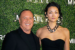"(L to R) The fashion designer Michael Kors and the model Ai Tominaga pose for the cameras at the event ""Michael Kors in Japan"" in the Tokyo National Museum, November 13, 2013. She wears the dress of Fall 2013 Collection designed by Michael Kors. The event is held to commemorate that Miranda Kerr with Michael Kors' dress will be on the cover of the magazine ""ELLE Japon"". (Photo by Rodrigo Reyes Marin/AFLO)"