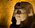Luxor, Egypt -- The head from a statue of Ramses II is displayed and illuminated outside Luxor Temple.  Luxor temple was built principally by two pharoahs, Ramses II and Amenhotep III, and was the companion temple to Karnak for worship of the Theban triad of gods, Amun, his wife Mut, and their son Khonsu. While Karnak was the home of Amun, his wife Mut and son Khonsu resided at Luxor.   © Rick Collier / RickCollier.com