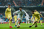 Isco Alarcon (C) of Real Madrid fights for the ball with Manuel Trigueros Munoz (R) of Villarreal CF during the La Liga 2017-18 match between Real Madrid and Villarreal CF at Santiago Bernabeu Stadium on January 13 2018 in Madrid, Spain. Photo by Diego Gonzalez / Power Sport Images