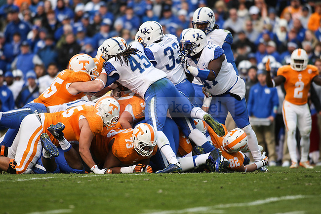 Kentucky and Tennessee players clash during the University of Kentucky vs. University of Tennessee football game at Neyland Stadium on Saturday, November 15, 2014 in Knoxville, Tn. Tennessee leads Kentucky 33-13. Photo by Adam Pennavaria | Staff