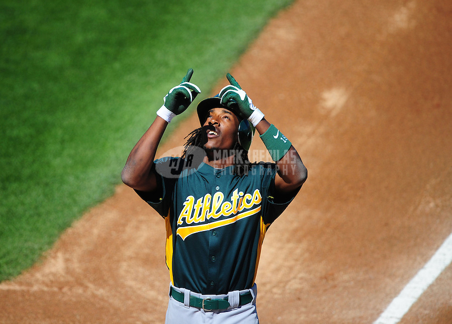 \Mar. 15, 2012; Surprise, AZ, USA; Oakland Athletics batter Jemile Weeks celebrates after hitting a home run in the first inning against the Texas Rangers at Surprise Stadium.  Mandatory Credit: Mark J. Rebilas-