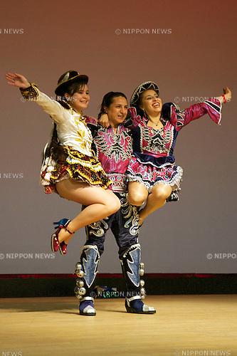 """Minamisanriku, Miyagi, Japan - Bolivians with traditional dress dance for Japanese refugees at Sports Koryu Mura in Minamisanriku, one year after the tsunami. The Latin group of volunteers """"Todos con Japon"""" visits Miyagi area during this Golden Week."""