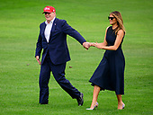 United States President Donald J. Trump and first lady Melania Trump wave to guests as they return to the South Lawn of the White House in Washington, DC from their European trip on Friday, June 7, 2019.<br /> Credit: Ron Sachs / CNP