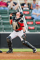 Kannapolis Intimidators catcher Michael Marjama (12) tracks a foul pop fly during the South Atlantic League game against the Delmarva Shorebirds at CMC-Northeast Stadium on August 8, 2013 in Kannapolis, North Carolina.  The Shorebirds defeated the Intimidators 4-3.  (Brian Westerholt/Four Seam Images)