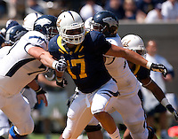 September 1, 2012: California's Brennan Scarlett fighting his way through Nevada's scrimmage line during a game at Memorial Stadium, Berkeley, Ca   Nevada defeated California 31 - 24