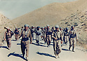 Iran 1981 .Left, in front, Akram Agha with Jowhar Assad, near the border, on their way to Iraq, with their peshmergas .Iran 1981 .A gauche, devant, Akram Agha avec a cote de lui, Jowhar Assad, avec leurs peshmergas en route pour l'Irak