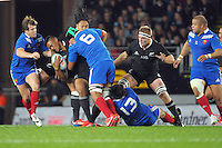 Thierry Dusautoir tackles Julian Savea as Ma'a Nonu and Sam Cane arrive in support during the international rugby match between the New Zealand All Blacks and France at Eden Park, Auckland, New Zealand on Saturday, 8 June 2013. Photo: Dave Lintott / lintottphoto.co.nz