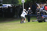 Luke Donald's caddy John McClarren has to move a post after Luke has a nightmare start sending his ball way into the trees after teeing off on the 1st hole during the Final Day of the BMW PGA Championship Championship at, Wentworth Club, Surrey, England, 29th May 2011. (Photo Eoin Clarke/Golffile 2011)