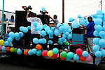 MUSIC FLOAT WITH BALLOONS IN ANNUAL CARNIVAL PARADE