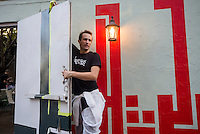 """New York, NY 18 September 2015 - French Graffiti artist L'Atlas at work on one of his """"Abstract Calligraphy"""" murals in the Soho neighborhood of Manhattan"""