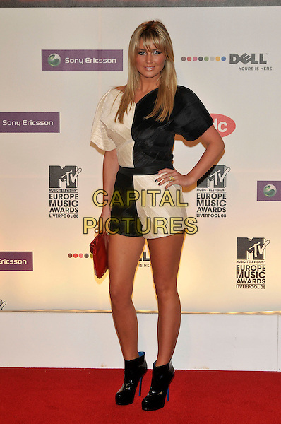 ALEX CURRAN.2008 MTV Europe Music Awards arrivals at Echo Arena, Liverpool, England..6th November 2008.EMA full length black white cream dress ankle boots patent hand on hip red clutch bag.CAP/PL.©Phil Loftus/Capital Pictures.