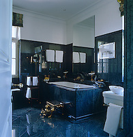 Blue-veined marble covers the floors and walls of this grand bathroom