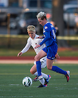 In a National Women's Soccer League Elite (NWSL) match, the Boston Breakers and  Washington Spirit drew 1-1, at the Dilboy Stadium on April 14, 2012.  Boston Breakers midfielder Joanna Lohman (11) intercepts a pass in front of Washington Spirit midfielder Lori Lindsey (6).