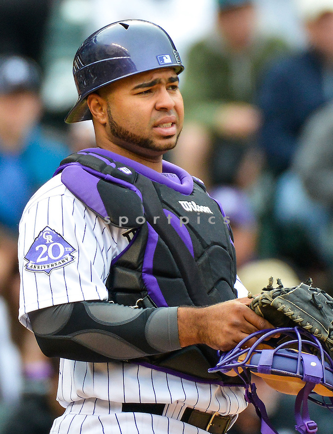 Colorado Rockies Wilin Rosario (20) during a game against the Tampa Bay Rays on May 5, 2013 at Coors Field in Denver, CO. The Rays beat the Rockies 8-3..