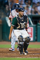 Greensboro Grasshoppers catcher Felix Castillo (14) chases after a pitch in the dirt during the game against the Greenville Drive at NewBridge Bank Park on August 17, 2015 in Greensboro, North Carolina.  The Drive defeated the Grasshoppers 5-4 in 13 innings.  (Brian Westerholt/Four Seam Images)