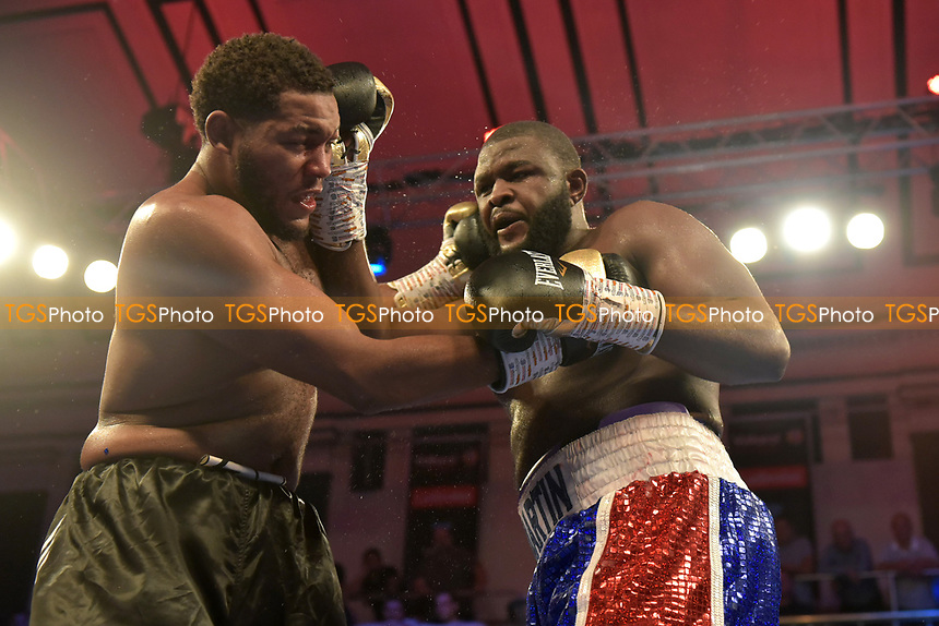 Michael Hunter (black shorts) defeats Martin Bakole during a Boxing Show at York Hall on 13th October 2018