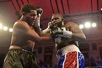 Michael Hunter (black shorts) defeats Martin Bakole during a Boxing Show at York Hall on 13th October 2018