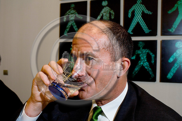 BRUSSELS - BELGIUM - 28 MAY 2008 -- John G. RICE, Vice Chairman GE and President and CEO for GE Infrrastructure drinking water from a glass after the Press Conference where GE Unveiled their agressive water reduction target to free up fresh water supplies. The company pledges to reduce fresh water use by 20% by 2012.  Photo: Erik Luntang/EUP-IMAGES