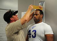 Jun. 13, 2009; Las Vegas, NV, USA; Mark Fenton is measured during the United Football League workout at Sam Boyd Stadium. Mandatory Credit: Mark J. Rebilas-