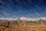 Star trails  on Lone Pine Peak and Mt. Whitney in the High Sierra from Alabama Hills
