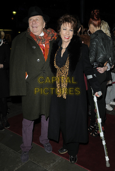 BARRY HUMPHREYS & KATHY LETTE.Press night for 'The Hurly Burly Show' at the Garrick Theatre, London, England, March 11th 2011..full length hat black fur collar coat red scarf grey gray leopard print cane.CAP/CAN.©Can Nguyen/Capital Pictures.