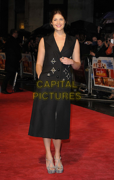 Gemma Arterton.attended the 'Song For Marion' May Fair Hotel gala screening, the 56th BFI London Film Festival day 10, Odeon West End cinema, Leicester Square, London, England, 19th October 2012..full length sleeveless black coat dress hand in pocket brooches  Prada grey gray platform shoes sandals buttons collar wedges embellished jewelled .CAP/CAN.©Can Nguyen/Capital Pictures.