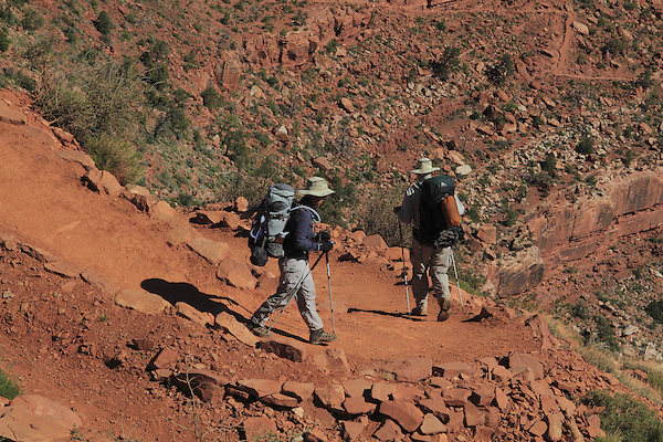 Two male, Caucasian backpackers hiking down the South Kaibab Trail to the Colorado River and Phantom Ranch Campground, Grand Canyon National Park, northern Arizona, USA . John offers private photo tours in Grand Canyon National Park and throughout Arizona, Utah and Colorado. Year-round.