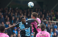 Gozie Ugwu of Wycombe Wanderers & Shaun Brisley of Northampton Town go up for the ball during the Sky Bet League 2 match between Wycombe Wanderers and Northampton Town at Adams Park, High Wycombe, England on 3 October 2015. Photo by Andy Rowland.