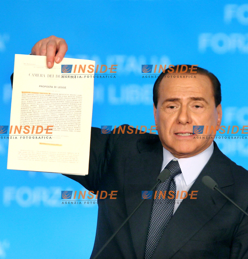 Italian Prime Minister Berlusconi reacts during a meeting in Rome April 4 , 2006. Berlusconi on Tuesday used a vulgar Italian word which means &quot;testicles&quot; to describe people planning to vote for the centre-left opposition at this weekend's general election.<br /> 04 Apr 2006<br /> REUTERS/Tony Gentile