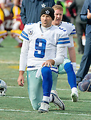 Dallas Cowboys quarterback Tony Romo (9) participates in stretching drills prior to the game against the Washington Redskins at FedEx Field in Landover, Maryland on Sunday, December 28, 2014.  <br /> Credit: Ron Sachs / CNP