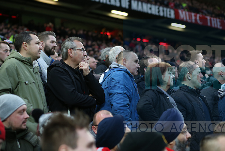 Nervous Manchester Utd fans watch the match during the English Premier League match at Old Trafford Stadium, Manchester. Picture date: December 11th, 2016. Pic Simon Bellis/Sportimage