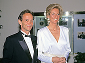 Actor/Singer Joel Grey, who will be performing this evening, and Nancy Rubin arrive at the White House in Washington, DC for the State Dinner honoring President Carlos Menem of Argentina on Thursday, November 14, 1991.<br /> Credit: Ron Sachs / CNP