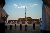 Children in communist Pioneer uniforms adjust their scarves in front of the citadel in Hue, Vietnam on 25 February 2010.