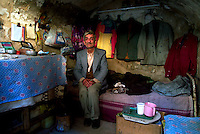 Baghdad, Iraq Feb 14, 2003.Mr. Abu Nagim, 76, a clothes repairer, lives alone in a 2m by 2m basement room in the Al Rashid souk.
