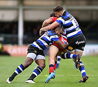 Semesa Rokoduguni and Elliott Stooke of Bath Rugby double-tackle Dean Hammond of Worcester Warriors. Aviva Premiership match, between Bath Rugby and Worcester Warriors on October 7, 2017 at the Recreation Ground in Bath, England. Photo by: Patrick Khachfe / Onside Images