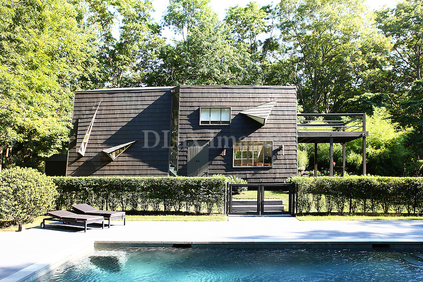 swimming pool in the garden<br /> <br /> The 1200sqft house was built in 1963 perched on over 5 wooded acres in Bridgehampton. It was a wonderful opportunity for the designer to create a compound and a future development for the property, decorating it with equal parts vintage and new pieces, clean modern classics. The house was purchased 2 years ago by a young couple who entertain family and friends.