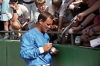 Kansas City Royals first baseman George Brett signs autographs during spring training circa 1989 at Baseball City Stadium in Davenport, Florida.  (MJA/Four Seam Images)