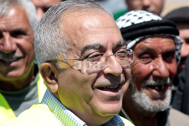 """Palestinian prime minister Salam Fayyad during his visits in the southern town of Yatta, near Hebron in the occupied West Bank, on March 30, 2011, as hundreds of people across Israel and Palestinian territories were holding a series of rallies marking """"Land Day,"""" recalling an incident in 1976 when Israeli troops shot and killed six people during protests against land confiscations .Photo by Najeh Hahlamoun"""