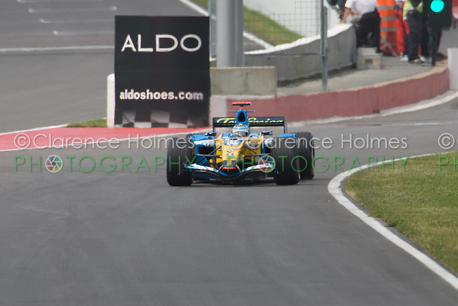 MONTREAL - JUNE 23: World champion Fernano Alonso of Renault F! leaves the pits during the second practice session on the Friday prior to race weekend of the Canadian F1 Grand Prix at the Circuit Gilles-Villeneuve June 23, 2006 in Montreal, Canada.