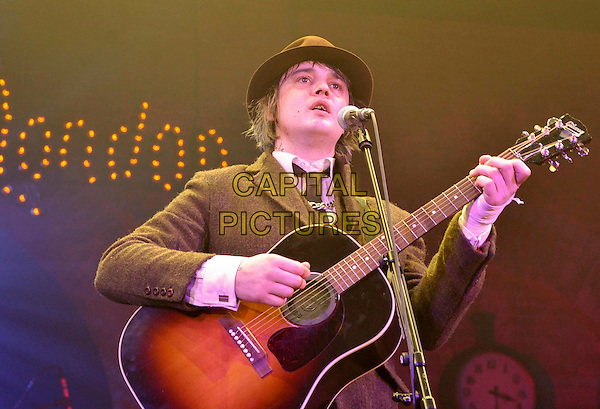 Pete Doherty.Rose Ball 2012 - Swinging London, Monte Carlo Bay Hotel, Monte Carlo, 24th March 2012..half length music gig singing live on stage concert performing guitar playing  black hat suit tie tweed jacket .CAP/PPG.©People Picture/Capital Pictures