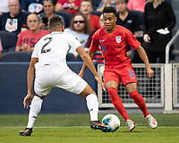 KANSAS CITY, KS - JUNE 26: Jonathan Lewis #18 challenges Francisco Palacios #2 during a game between United States and Panama at Children's Mercy Park on June 26, 2019 in Kansas City, Kansas.