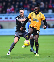Cambridge United's Adebayo Azeez shields the ball from Lincoln City's Jason Shackell<br /> <br /> Photographer Andrew Vaughan/CameraSport<br /> <br /> The EFL Sky Bet League Two - Cambridge United v Lincoln City - Saturday 29th December 2018  - Abbey Stadium - Cambridge<br /> <br /> World Copyright © 2018 CameraSport. All rights reserved. 43 Linden Ave. Countesthorpe. Leicester. England. LE8 5PG - Tel: +44 (0) 116 277 4147 - admin@camerasport.com - www.camerasport.com