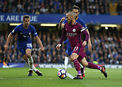 30th September 2017, Stamford Bridge, London, England; EPL Premier League football, Chelsea versus Manchester City; David Silva of Manchester City runs passed Cesc Fabregas of Chelsea and Cesar Azpilicueta of Chelsea