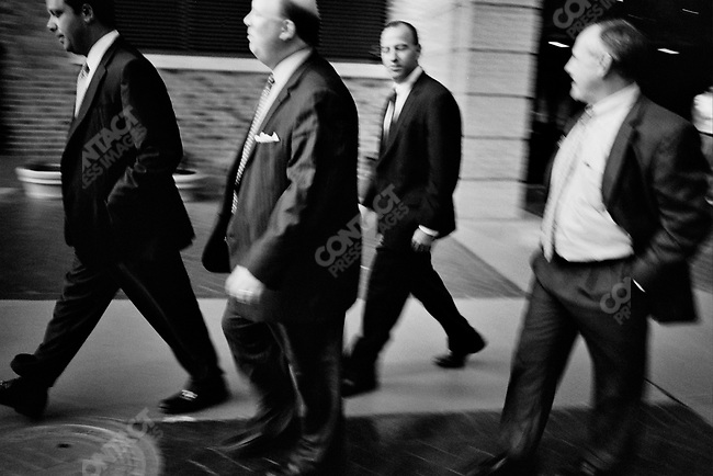 Businessmen outside the Peabody Hotel, Memphis, Tennessee, USA, September 2007