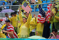 Aug. 10, 2008; Beijing, CHINA; United States fans celebrate in the rain after USA defeated Japan during the womens beach volleyball at the Chaoyang Park Beach Volleyball Ground in the 2008 Beijing Olympic Games. Mandatory Credit: Mark J. Rebilas-